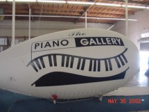 Helium Advertising Blimps Helium Blimps Helium Blimp Designs: Custom Advertising Blimps for Piano Retail Store